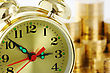 Face Old-fashioned Clock Dial On Golden Coins Background, Time Is Money Concept stock photography