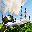 Industry Old Gas Mask On A Green Grass On A Background Of Smoking Chimneys Polluting The Planet stock photo