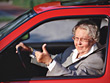 Old Lady Driving Giving Thumbs-Up stock photo