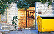 Old Metallic Rusty Gate And Garbage Bin At The House stock photo