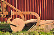 Old Plough Deserted By The Barn Wall, Westland, New Zealand stock photo