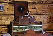 Old Radio And Turntable In Country Cottage With Wooden Wall In Background. stock image