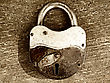 Old Rusty Padlock On Wooden Background stock photography