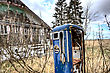 Old Vintage Gas Pump And Abandoned House stock image