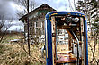 Old Vintage Gas Pump And Abandoned House stock photo