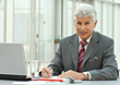 Older Business Man With Laptop stock photography