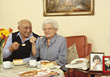 Retiring Older Couple Having Cake stock photography