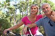 Older Couple Riding Bikes stock image