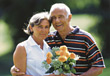 Older Couple with Roses stock photo