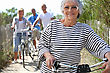 Older Woman And Friends On A Bike Ride stock photo