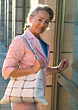 Older Woman Going Inside Building stock photo
