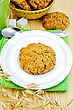One Cookie On A White Plate, Spoon, Sugar, Cup, Wicker Basket With Cookies, Stalks Of Oats On A Wooden Board