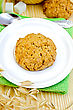 One Cookie On A White Plate, Spoon, Sugar, Cup, Basket Weaving, Stalks Of Oats On A Wooden Board stock photo