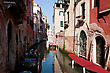 Journey One Of The Many Canals Of Venice, Italy stock photo