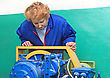 Machinery Operator Woman-engineer In Machine Room (elevator) Check The Mechanical Equipment stock image