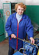 Operator Woman-engineer In Machine Room (elevator) Check The Mechanical Equipment