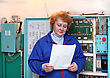 Operator Woman-engineer In Machine Room (elevator) Near Electronic Cabinet stock photo