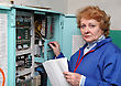 Operator Woman-engineer In Machine Room (elevator) Near Electronic Cabinet stock image
