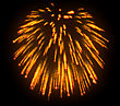 Orange Festive Fireworks At Night Over Black Background