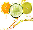 Orange,Lemon And Lime Slices With Juice Splash stock image