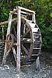 Original Water Wheel In Bush Near Ross Township, West Coast, South Island, New Zealand stock photography