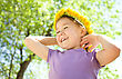 Outdoor Portrait Of A Cute Little Girl With Dandelion Wreath stock photo
