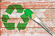 Eco Paintbrush And Recycle Symbol Painted On The Wooden Wall stock image