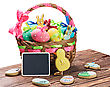 Painted Eggs In A Basket On A Table On A White Background