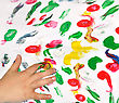 Painting With Her Fingers With Different Color Paint stock photography