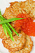 Pancakes With Red Caviar And Green Onion Closeup Dish stock photography