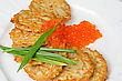 Pancakes With Red Caviar And Green Onion Closeup Dish stock image