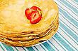 Pancakes Stacked On A Plate With Strawberries On A Green Striped Napkin stock photography