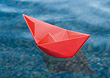 Paper Boat Floating on Water stock image