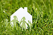 Friendly Paper Cut Of Family With House In A Green Grass stock image