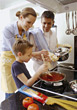 Parents and Son Cooking Spagetti stock photo