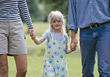Parents Walking Young Daughter stock photography