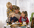 parents happy family breakfast eating happiness stock photo