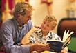 dad reading parent learn study son stock photo