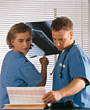 nurses reading physicians medical xray surgeons stock photo