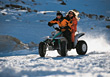 winter vacation snow driving couple ATV stock photo