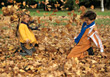 playing child laughing leafs autumn fall stock photo