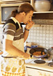 stove cook single male prepare kitchen stock photo