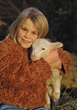 child farm girl pets sheep lamb stock photo