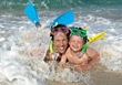 water dad parents waves goggles sea stock image