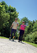 walking mature outdoor active people couples stock photo