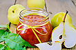 Pear Jam In A Glass Jar, Fresh Pears, Twigs With Leaves On A Wooden Board