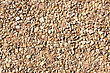 Pebble Background At Sun Light. Stone Texture stock photo