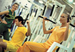 People In Gym with Personal Trainer stock photo