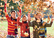 People Throwing Leaves Up In The Air stock photo