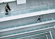 People Walking On Several Floors In Office Atrium stock photography